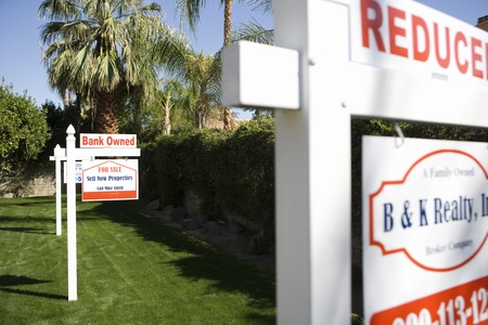 foreclosed: Real Estate Signs at Foreclosed Property