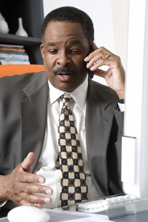 50 to 55 years old: Businessman Talking on Cell Phone