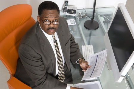Businessman at His Desk Stock Photo - 12547734