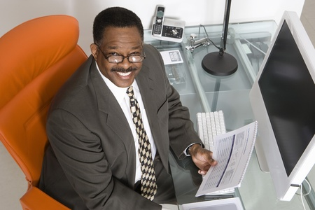 Businessman at His Desk Stock Photo - 12548135