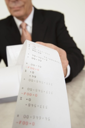 Businessman Looking at Calculator Paper Stock Photo - 12548145