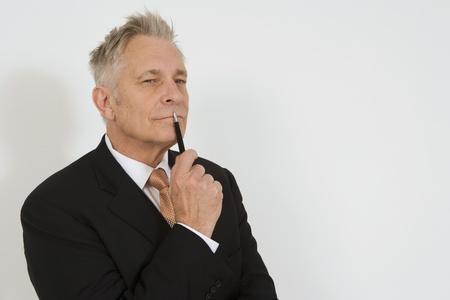 65 70: Businessman Holding Pen