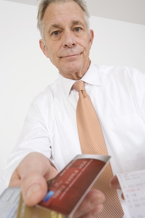 65 70 years: Businessman Holding Credit Cards