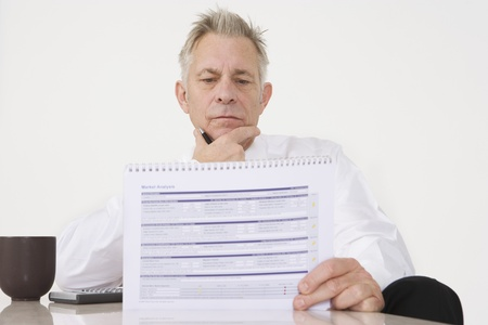 Businessman Holding Paperwork Stock Photo - 12548175