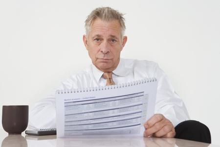 Businessman Holding Paperwork Stock Photo - 12548176