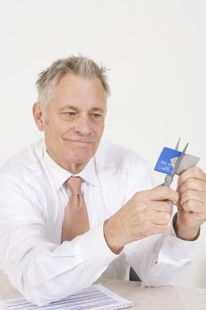 Man Cutting up Credit Card Stock Photo - 12548184