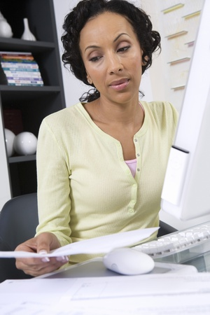 age 35 40 years: Woman Working at a Computer