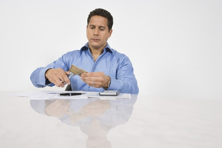Man Cutting up a Credit Card Stock Photo - 12548189