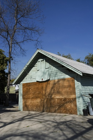 desertion: Boarded Up Garage of Empty House