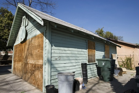 Boarded Up Garage of Empty House Stock Photo - 12548193