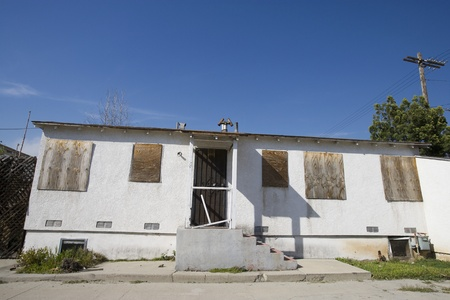 desertion: Abandoned House With Boarded Up Windows