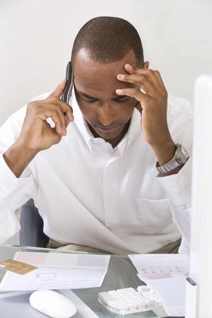 Anxious Man Doing Finances