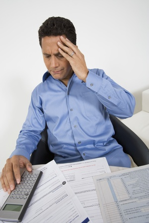 Man with a Financial Headache Stock Photo - 12548204