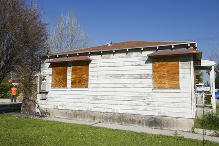political and social issues: Abandoned House With Boarded Up Windows