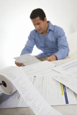 fortysomething: Man Calculating Finances LANG_EVOIMAGES