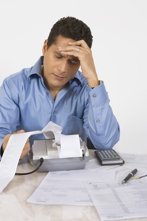 maladies: Man Calculating Finances LANG_EVOIMAGES