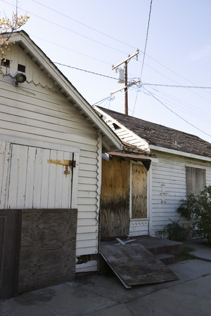 political and social issues: Abandoned House With Boarded Up Door LANG_EVOIMAGES