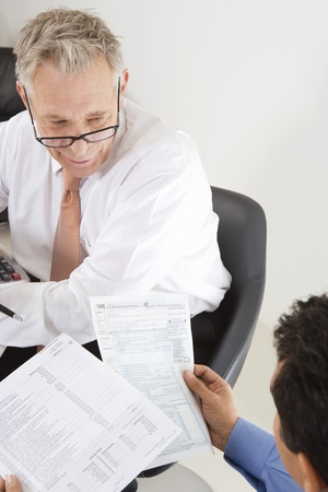 65 70 years: Businessmen Working in Office