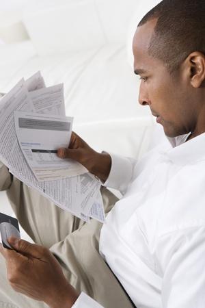 Man Checking Bills