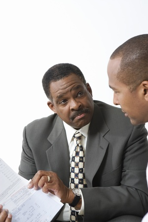 35 to 40 year olds: Accountant and Client Going over Bills LANG_EVOIMAGES