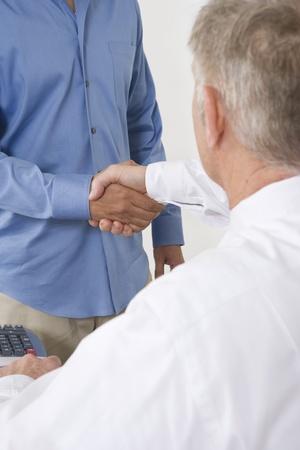 Businessmen Shaking Hands Stock Photo - 12548230