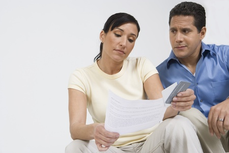 Couple Looking at Credit Card Bill Stock Photo - 12548238