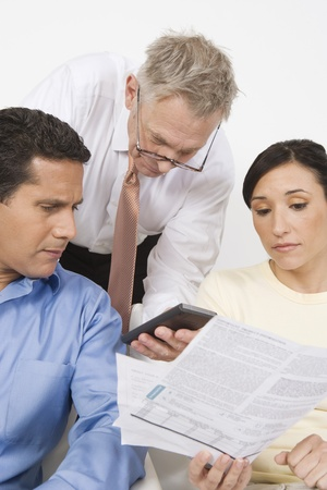 65 70: Businessman Assisting Couple