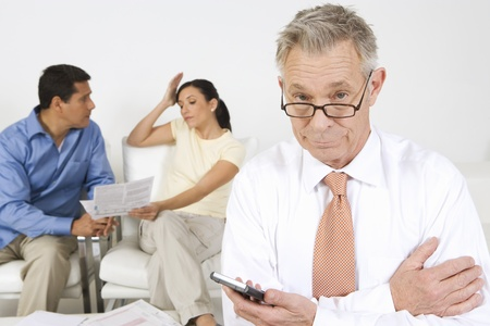 40 to 45 year olds: Businessman Assisting Couple
