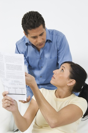 45 to 50 years old: Couple Looking at Tax Form