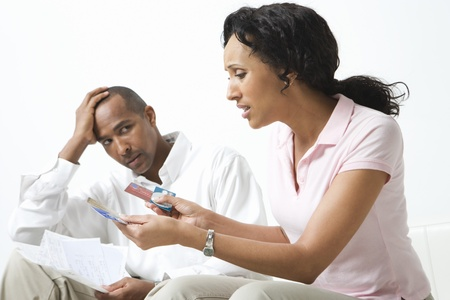 Couple Discussing Bills Stock Photo