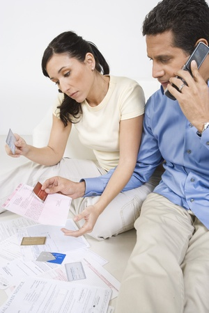 45 to 50 years old: Couple Holding Credit Cards LANG_EVOIMAGES