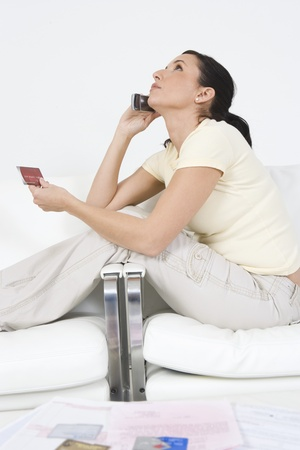 30 to 35 year olds: Woman Placing Order on Cell Phone