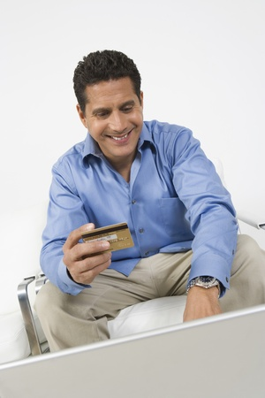 45 to 50 years old: Man Holding Credit Card LANG_EVOIMAGES