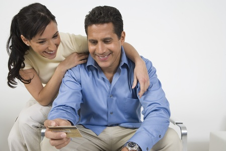 35 to 40 year olds: Couple Holding Credit Card