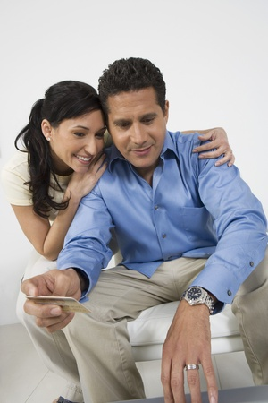Couple Holding Credit Card Stock Photo - 12548269