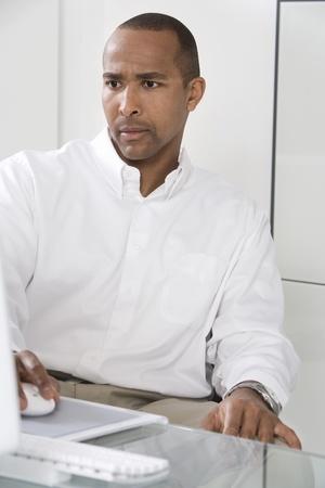 Man Using a Computer Stock Photo - 12548281