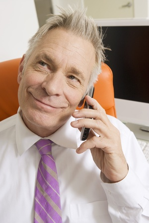 65 70: Businessman Using Cell Phone