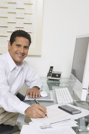 business roles: Businessman Working at Desk
