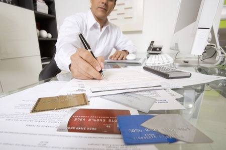 55 years old: Businessman Working at Desk