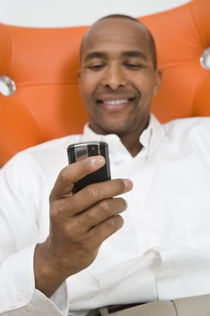 tweeting: Man Using a Cell Phone