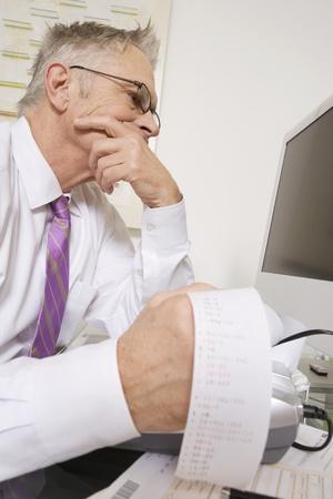 65 70 years: Businessman Working at Desk