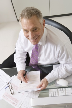 upper half: Businessman Working at Desk