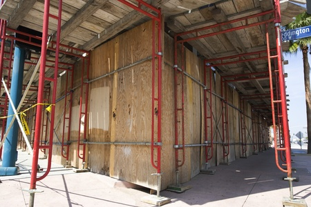 Scaffolding Around Boarded Up Property Stock Photo - 12548334