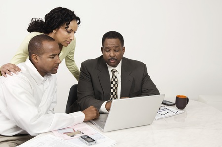 chartered accountant: Couple and Accountant Using Laptop