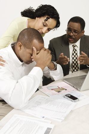 Accountant Giving Couple Bad News Stock Photo