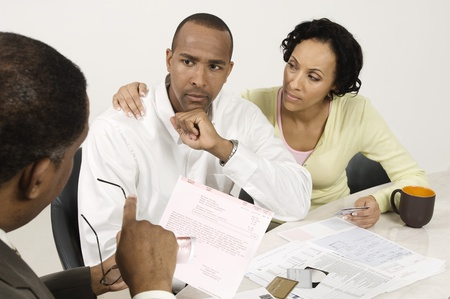 Couple Talking with Accountant