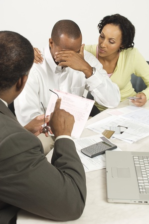 chartered accountant: Accountant Giving Couple Bad News LANG_EVOIMAGES