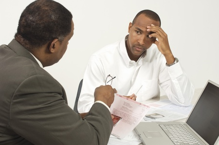 50 to 55 years old: Accountant Talking to Client