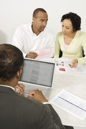 Couple Seeing Accountant Stock Photo - 12548354