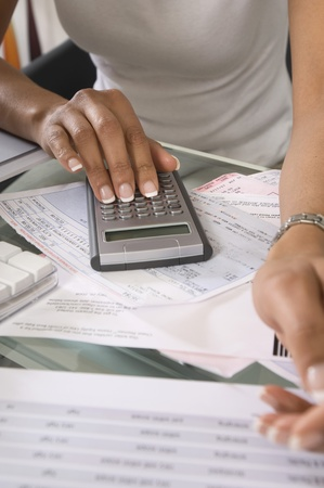 cropped off: Woman Calculating Bills